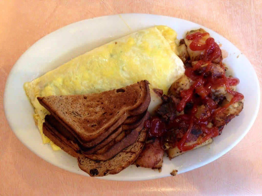 Spanakopita omelet, hasbrowns, raisin toast